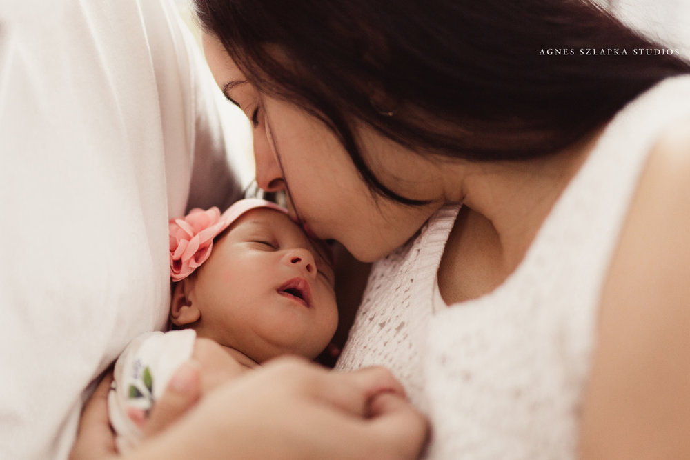 mom kissing baby girls forehead | cleveland, ohio newborn photographer