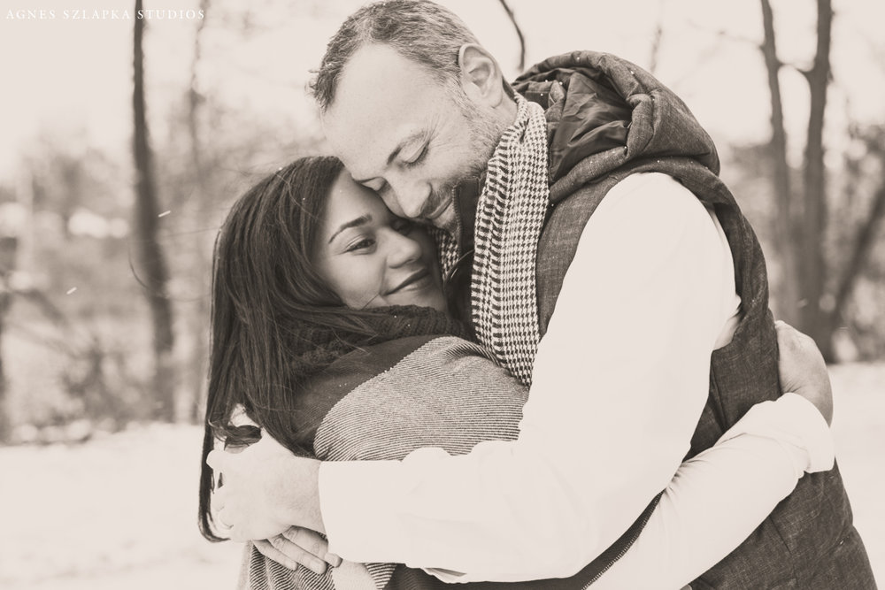 husband and wife hugging each other close on frosty day | cleveland, ohio family photographer