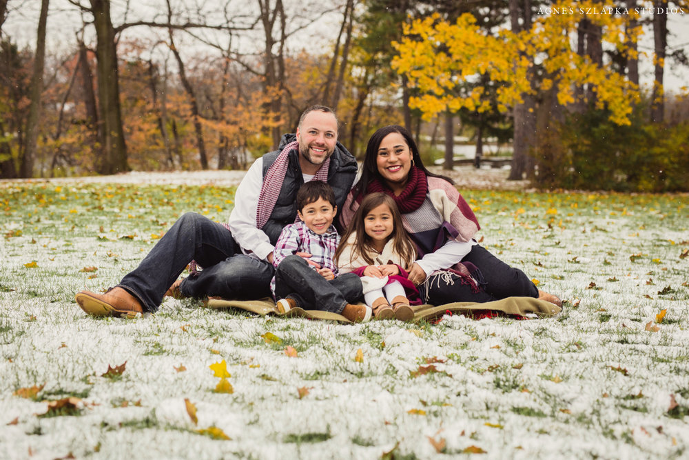 family of four sitting on blanket for winter pictures | cleveland, ohio kids portrait photos