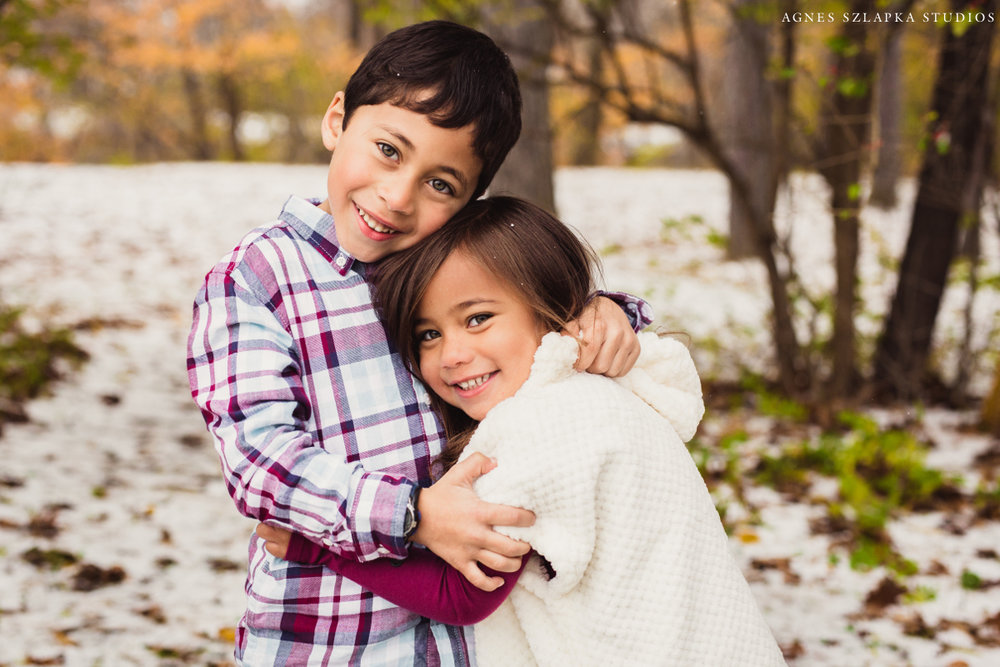 siblings brother and sister holding close on winter day | cleveland, ohio kids photography