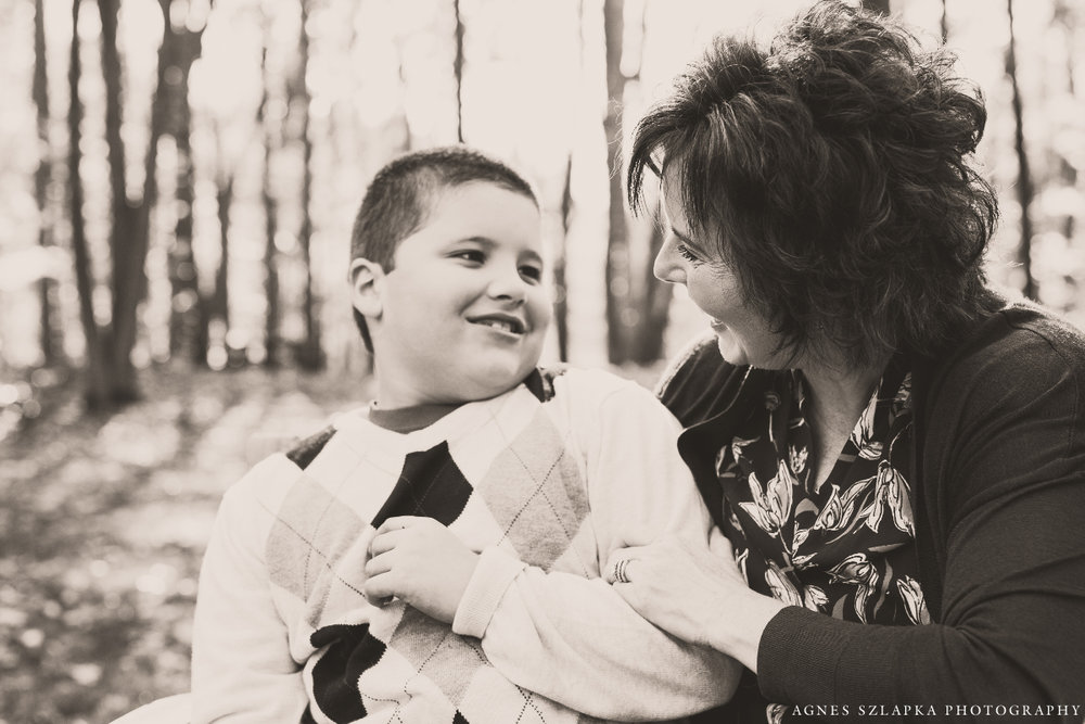 mother with autistic son laughing | cleveland, ohio family photographer