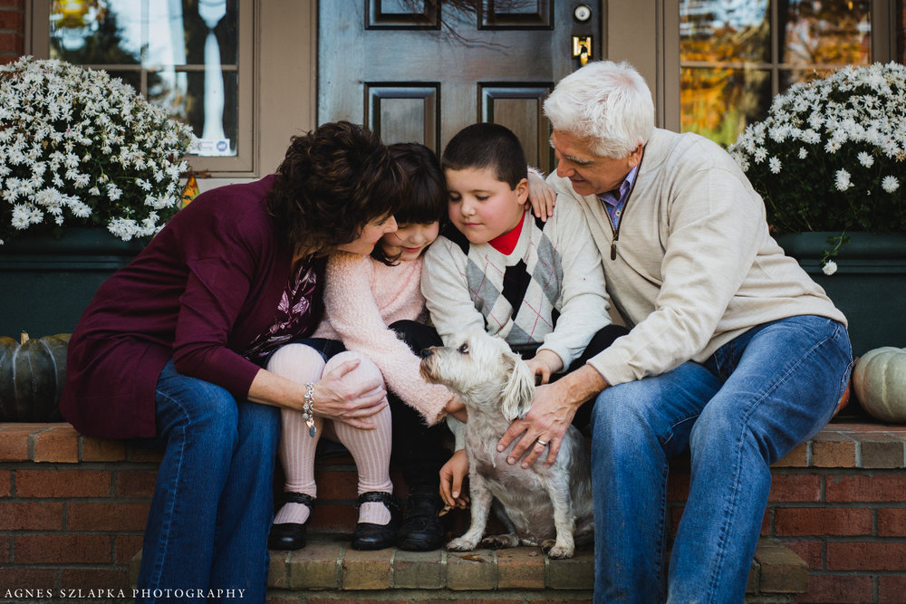 family with two kids sitting on front porch | cleveland, ohio portrait photographer