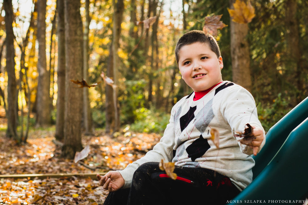 autistic boy on swing set | chagrin falls, ohio family photographer