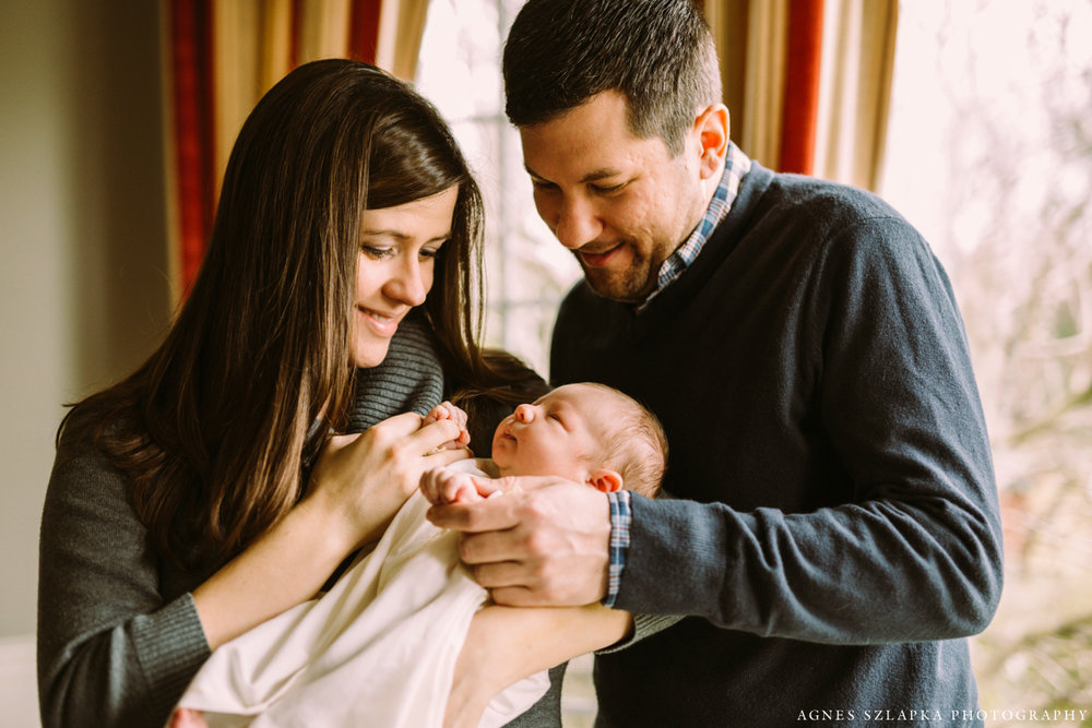 mom and dad holding baby daughters hands | cleveland, ohio newborn photos