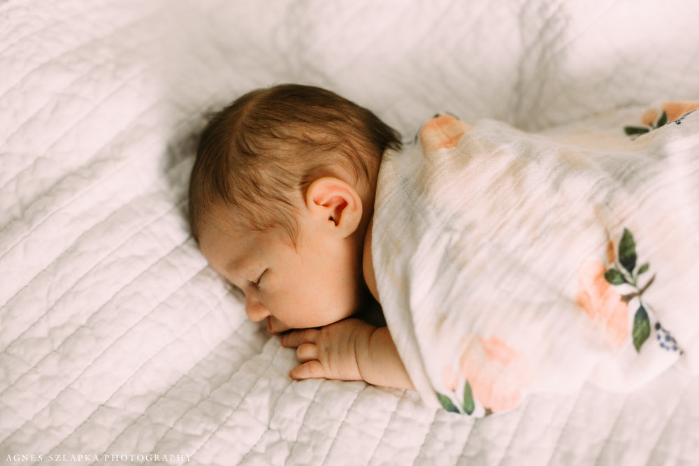two week old baby girl sleeping on bed | cleveland, ohio lifestyle newborn photography