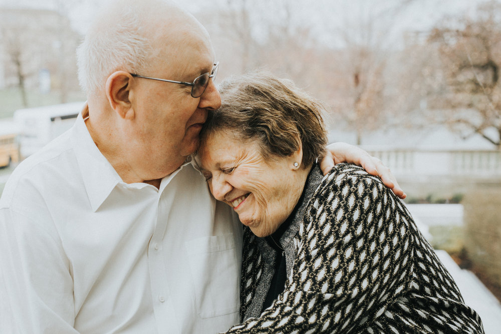 older senior citizen man kissing wife on forehead | cleveland, ohio family photographer