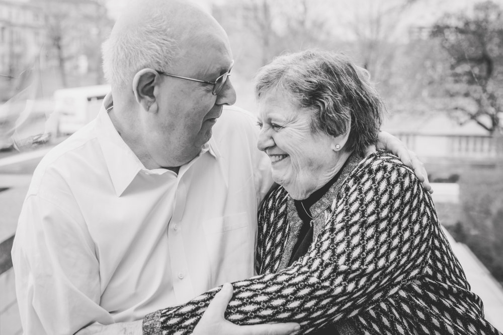 older couple embracing and laughing to each other | cleveland, ohio family photographer
