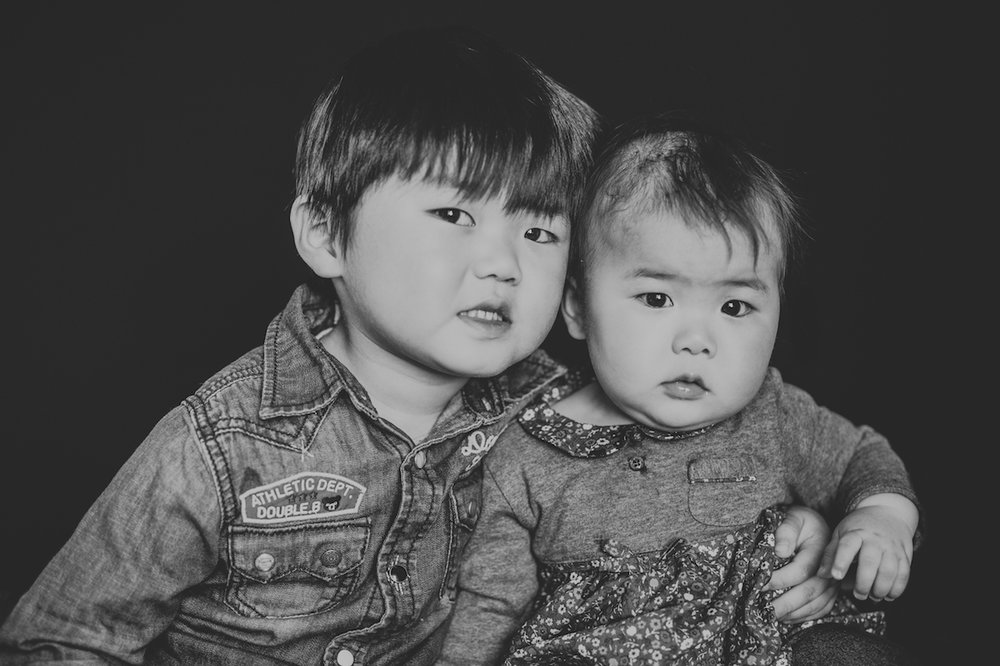 asian brother and sister hugging and smiling | cleveland, ohio school portraits of kids
