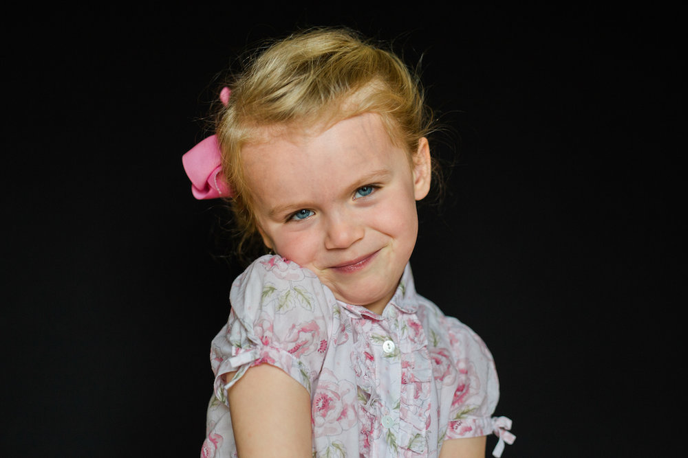 five year of age girl with floral shirt laughing | cleveland, ohio kids school photographer