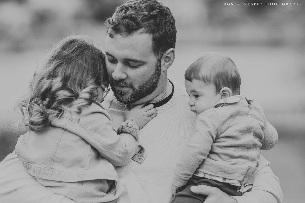 father holding two small children in arms | cleveland, spring family photographer