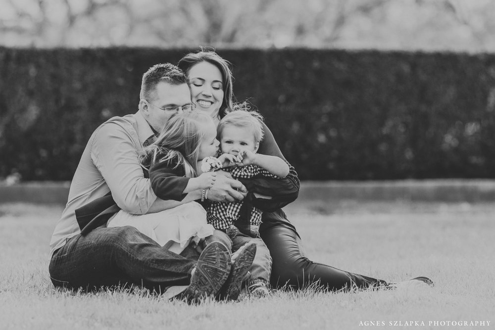 parents cuddling little children on grass | cleveland, ohio family photographer