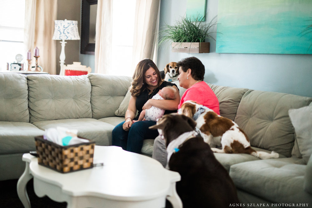 grandmother sitting on couch with grandson | cleveland lifestyle newborn photographer