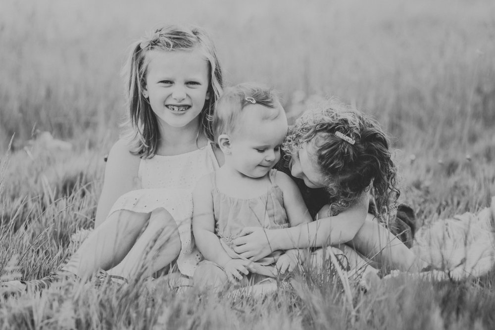 three little girls sitting on grass laughing | cleveland, ohio lifestyle family photos