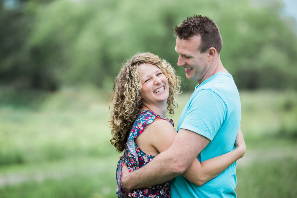 husband and wife embracing and smiling | cleveland, ohio family photographer