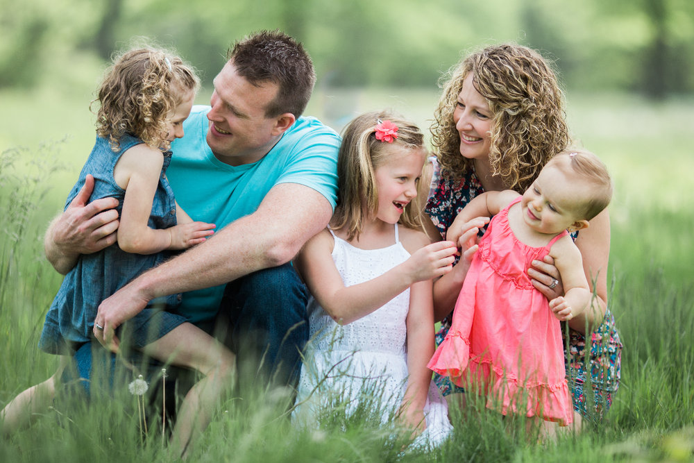 family of five cuddled together on blanket outdoors | cleveland, ohio lifestyle photographer