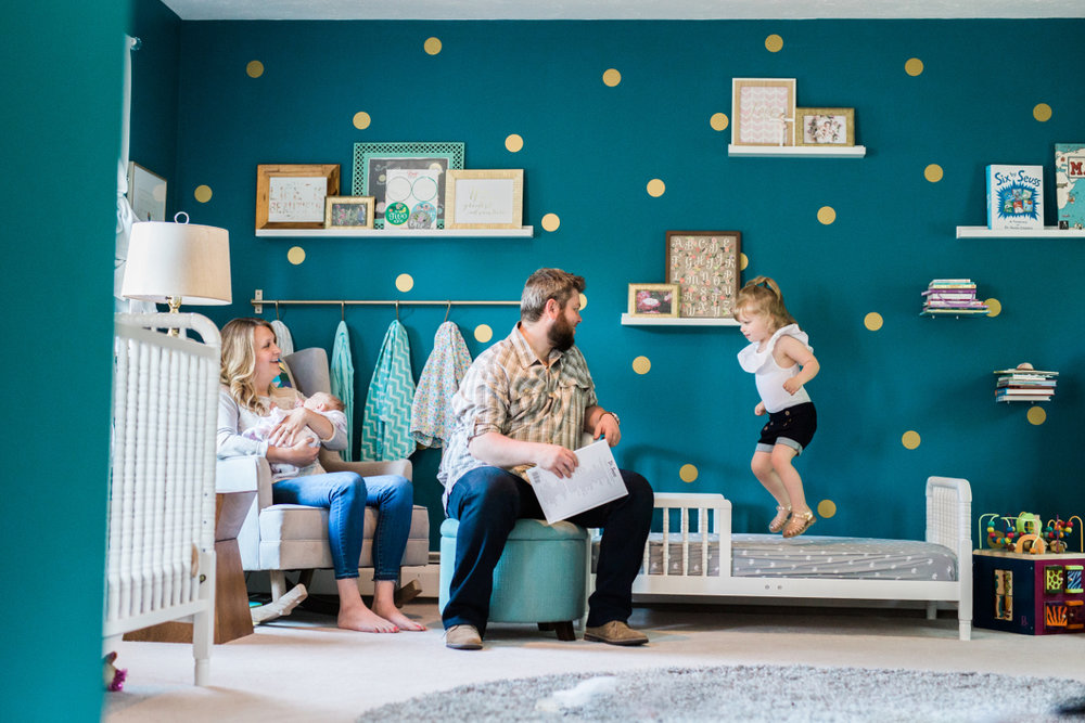 parents reading book to small children in nursery | cleveland, oh lifestyle family photographer