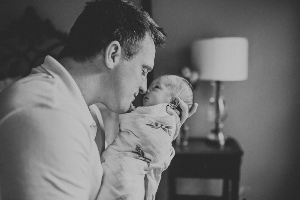 father kissing baby girl | cleveland, oh lifestyle newborn photography