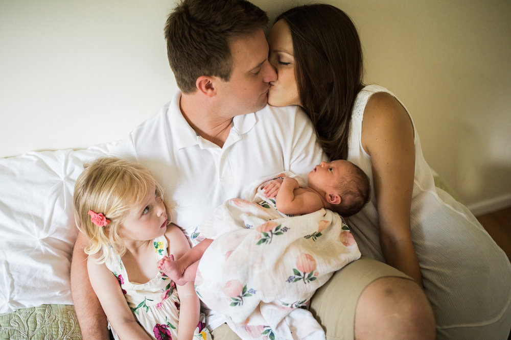 family of four and parents kissing | cleveland, ohio baby photos