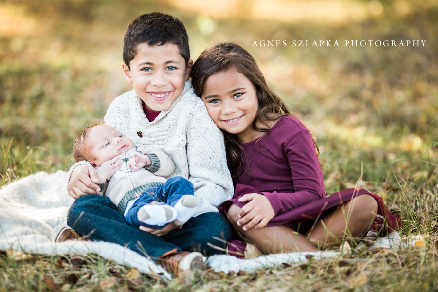 older brother and sister holding infant baby | cleveland, family photography