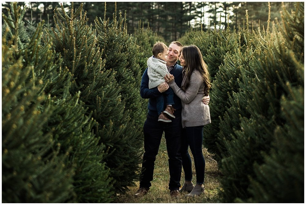 family of three standing among pine trees | cleveland lifestyle photographer