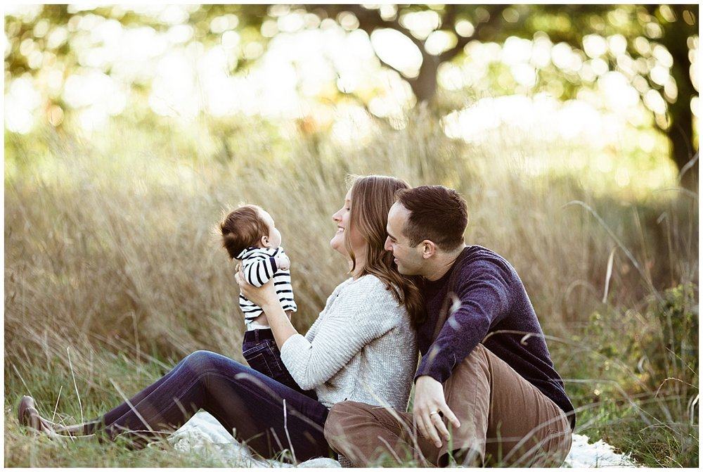 mom holding baby son in arms with dad  | cleveland, lifestyle newborn photos