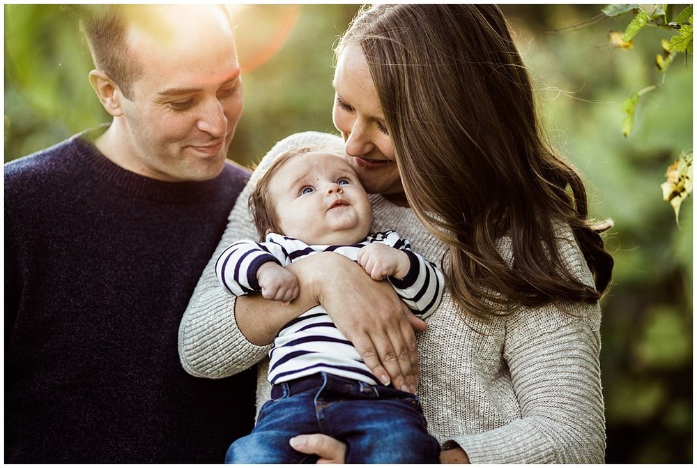 mom and dad lovingly hugging baby boy | cleveland, OH newborn photos