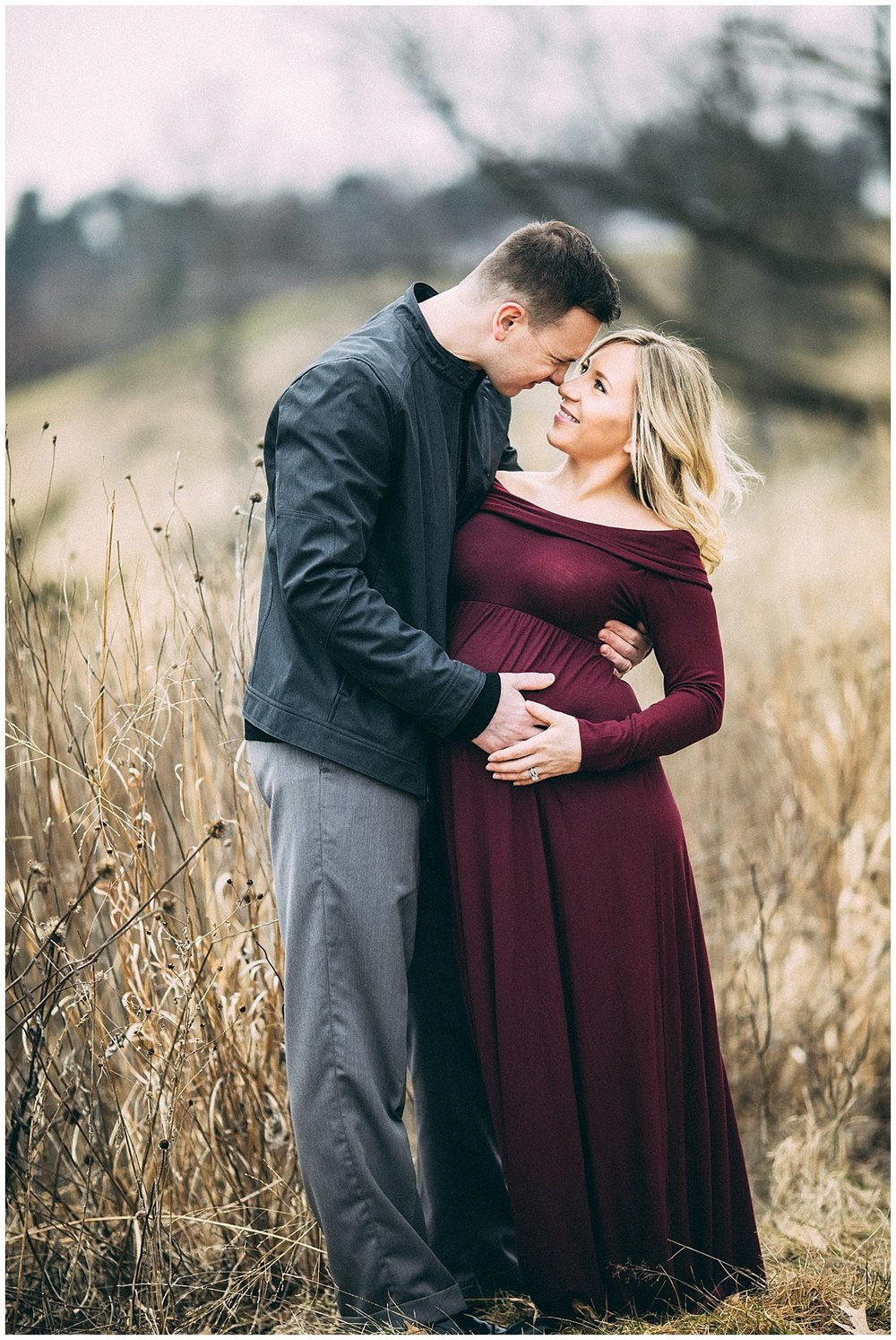 expecting parents kissing in the park | cleveland, OH maternity photographer