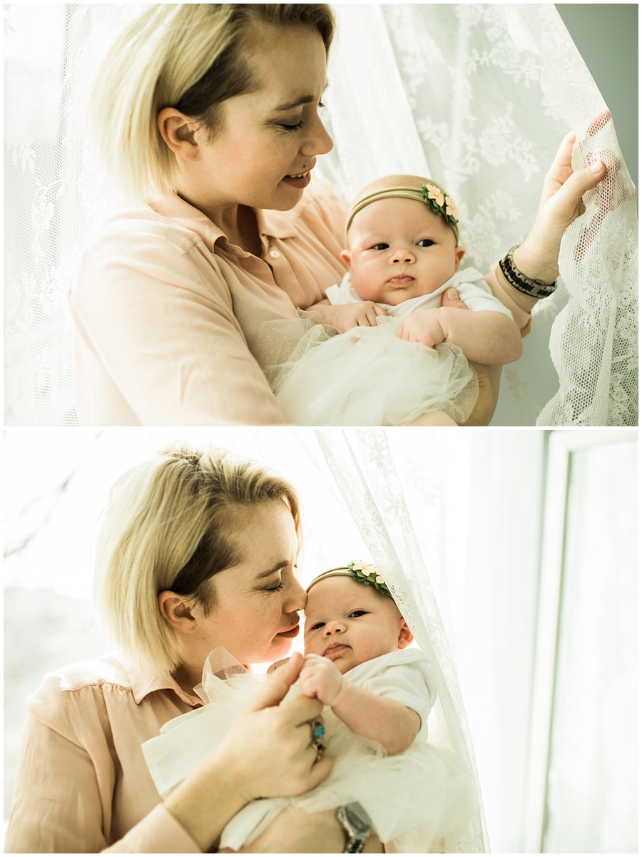 baby girl with mommy near window curtains | cleveland, OH lifestyle newborn photographer