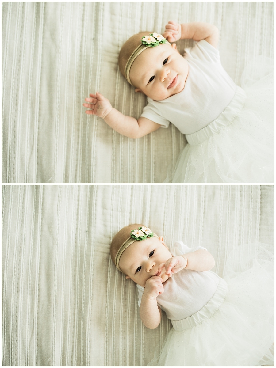 two month old infant baby girl on bed | cleveland, Ohio baby photographer