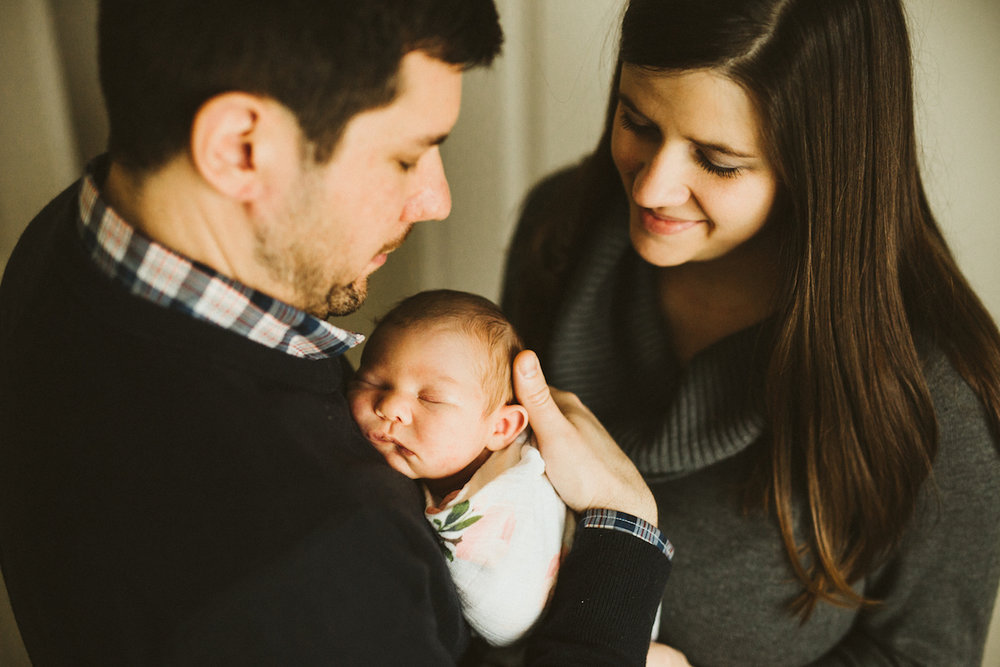 parents adoring sleeping baby daughter | cleveland, OH baby photographer