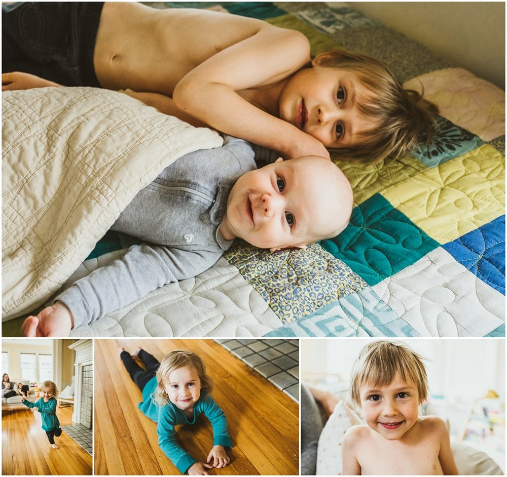 big brother with younger sibling on bed | cleveland, OH newborn photographer