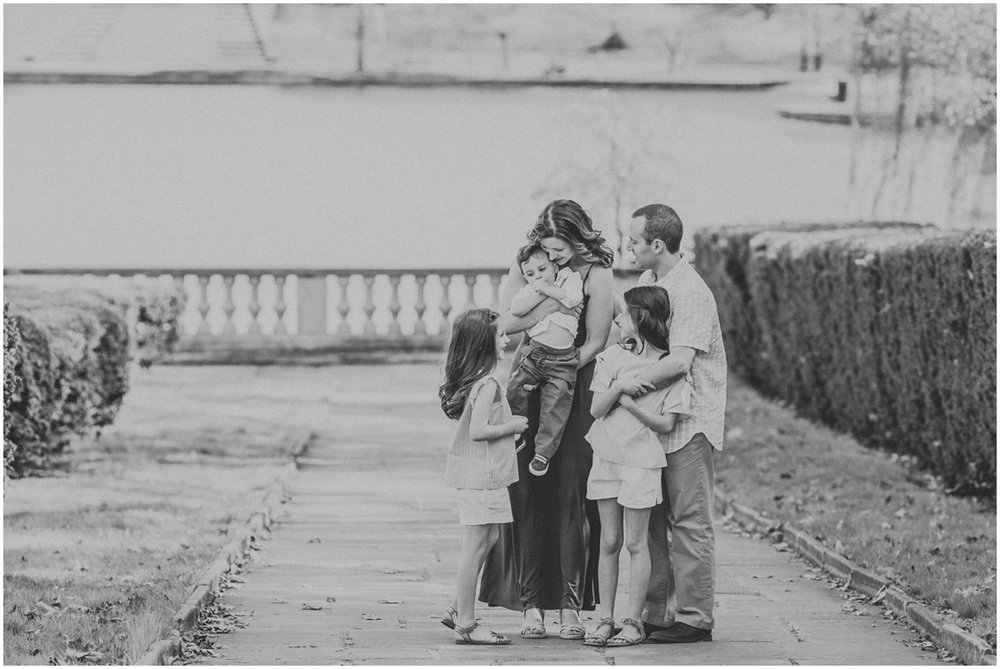 parents and three kids hugging close | cleveland, oh family photographer