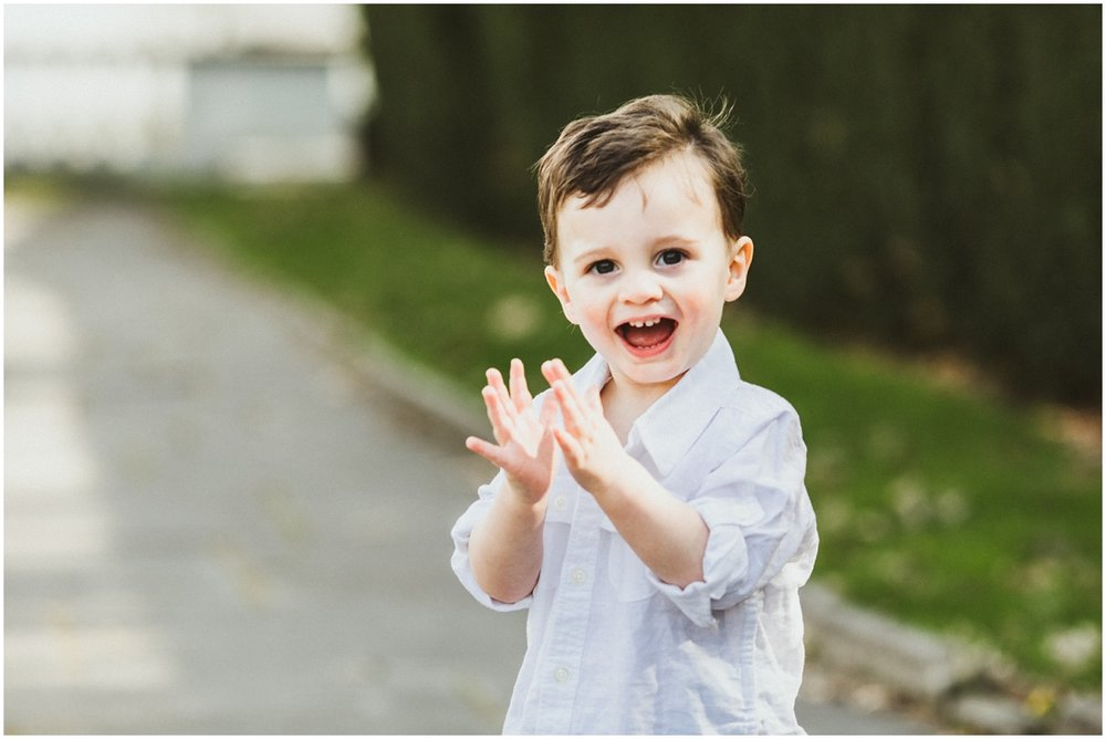 one year old boy clapping and smiling | cleveland, oh family photographer