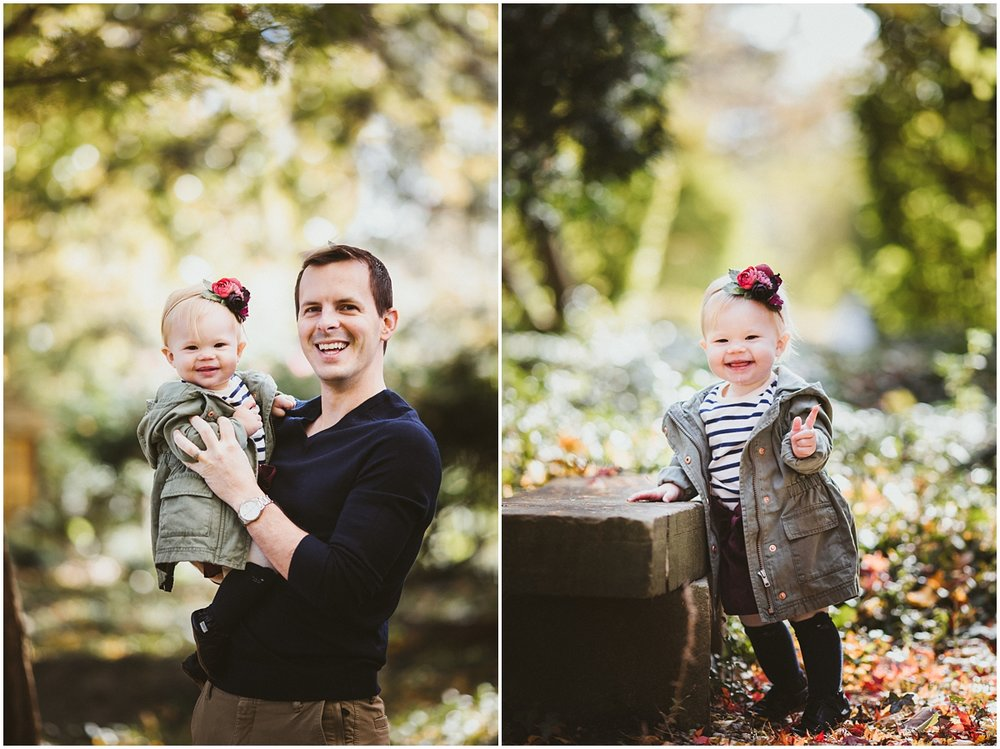 dad holding smiling baby girl in arms | cleveland, baby photographer