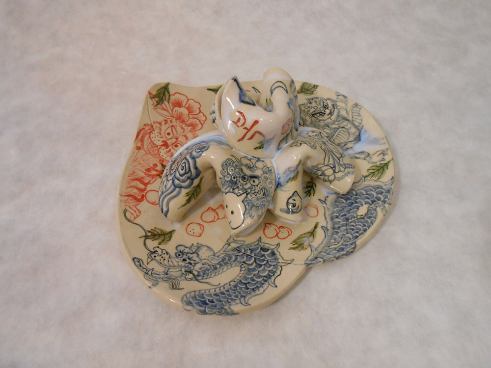 "Jiha Moon  Peach Plate 2, (dragon and red tiger) , 2015 Earthenware ceramic 10.5 "" x 11""x 4.5"""