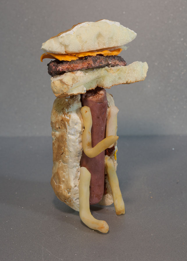 "Wise Burger , 2016 Paper pulp, porcelain, wood filler, epoxy resin, wax, foam, acrylic paint, oil paint 8"" x 4"" x 4"""
