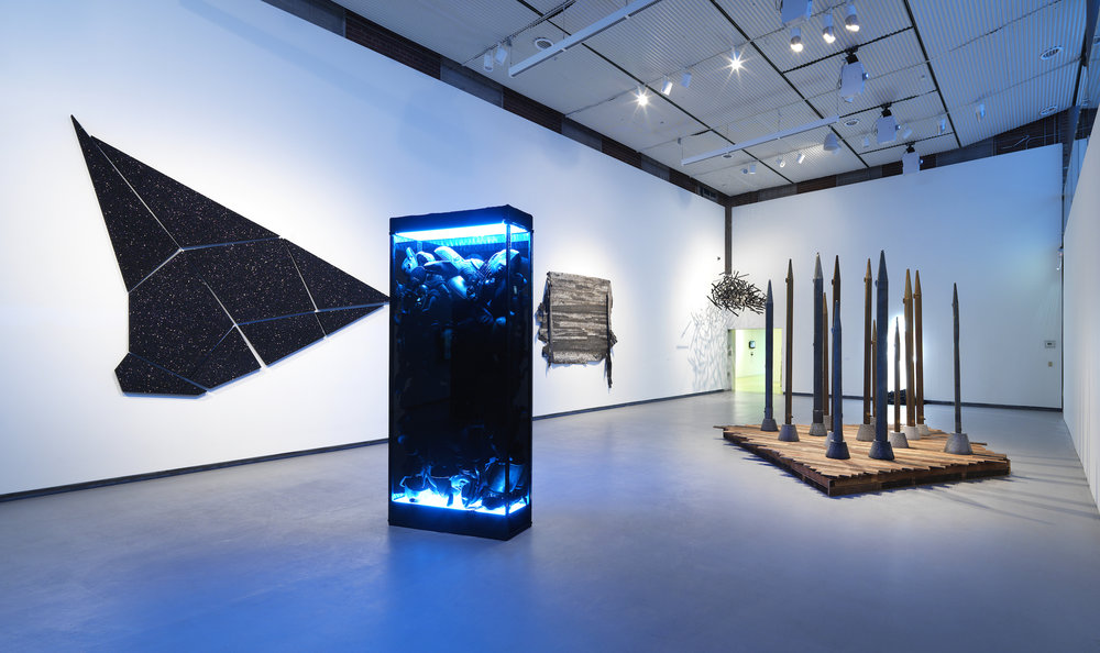 Jefferson Pinder  Installation view (left to right) of:   Black Portal Monolith (Dreamcatcher) Thin Skin / Shock Layer Gauntlet Moriaen's Shadow    In exhibition entitled  Onyx Odyssey   At Hyde Park Art Center, Chicago, IL, 2015  (for scale reference)