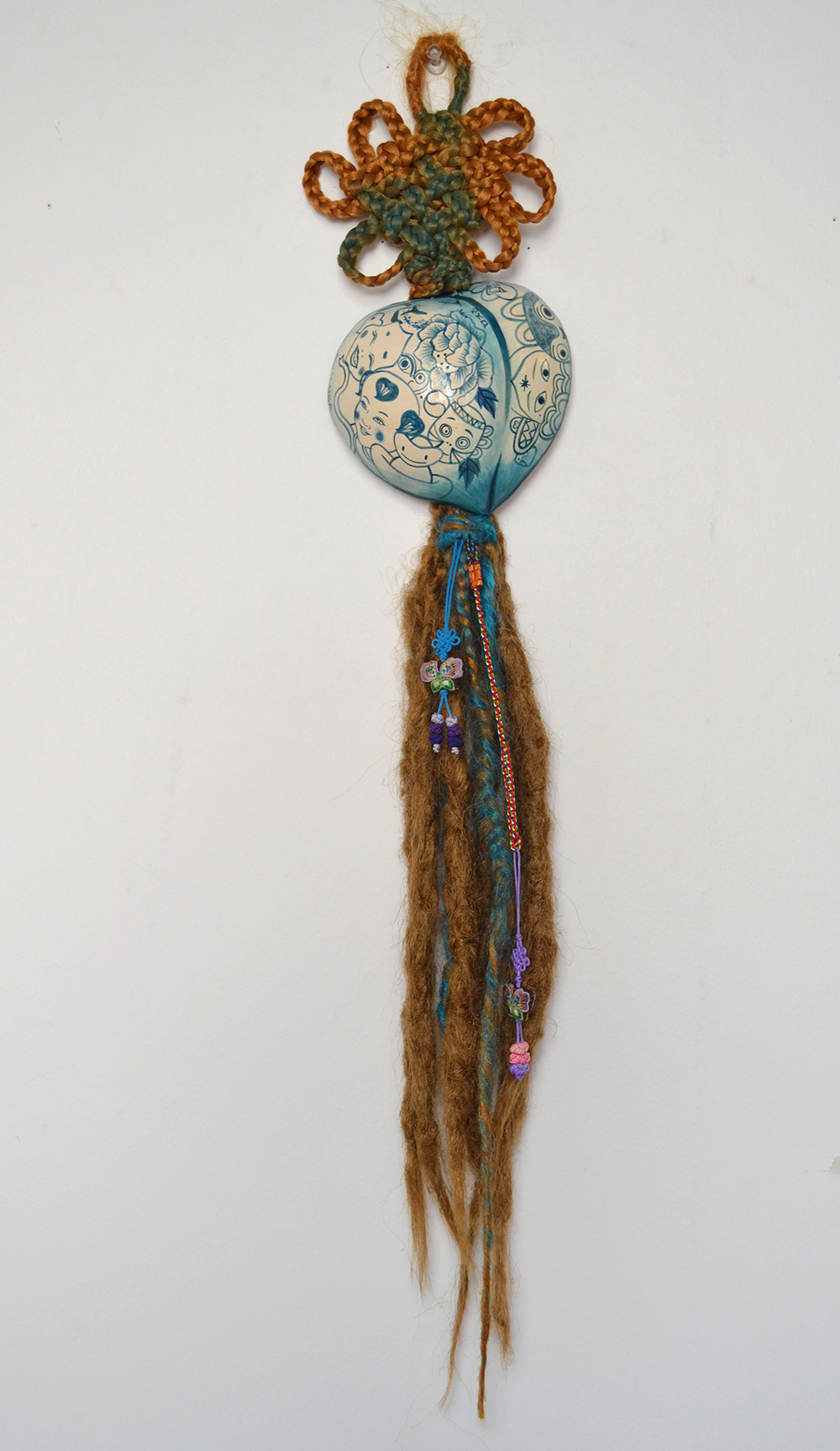 "Jiha Moon  Gloria  Ceramic, hand-knotted synthetic hair, acrylic paint, found objects 27"" x 5"" x 1.5"" 2013"