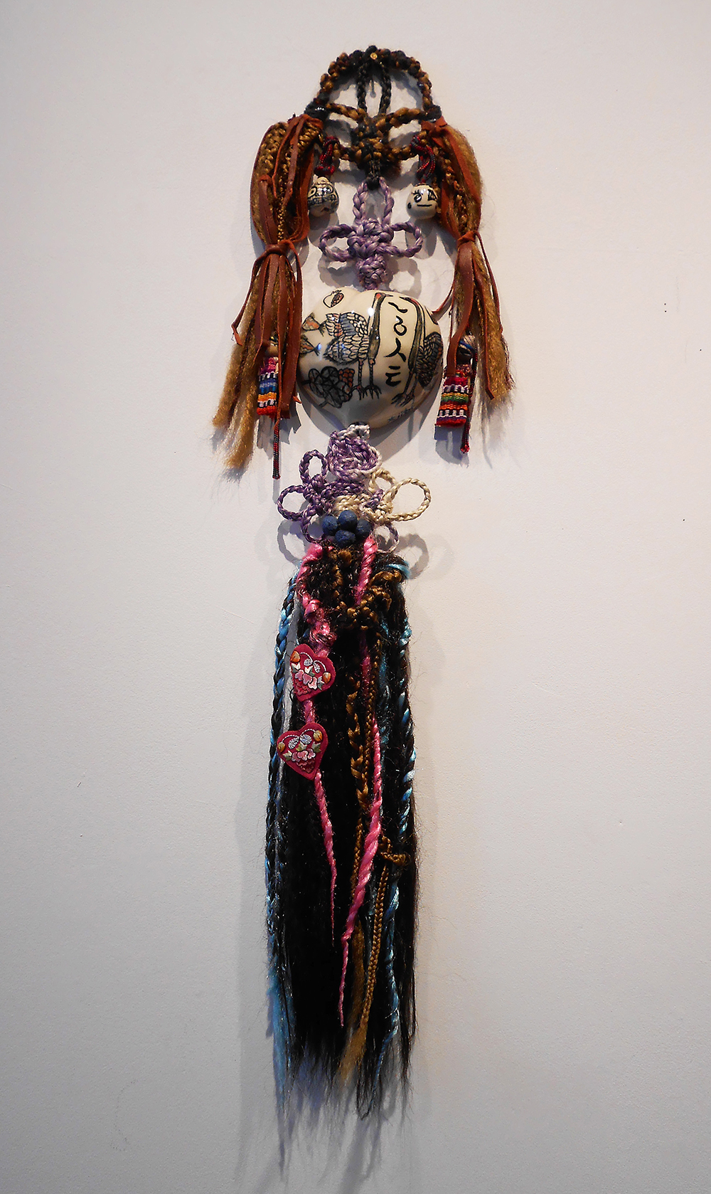 "Jiha Moon  Double Ginger  Ceramic, hand-knotted synthetic hair, found objects, Hanji beads, shoelaces, leather, wire 28"" x 8"" x 2"" 2014"