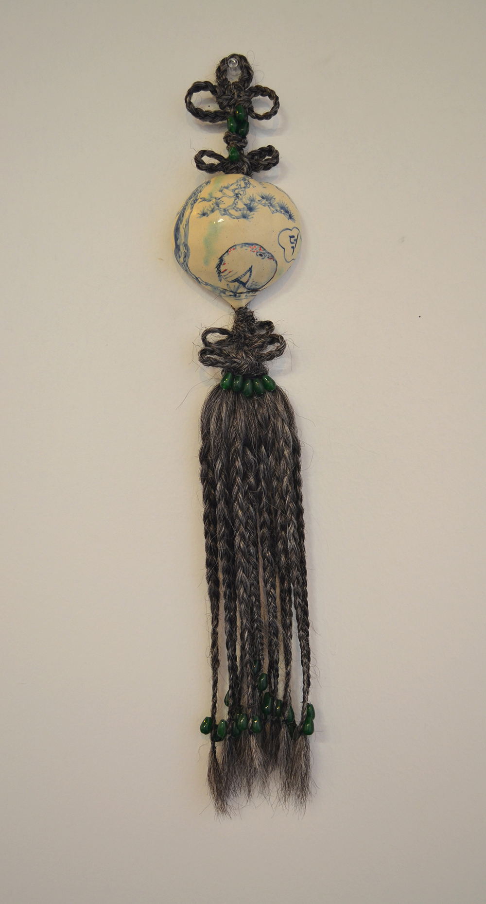 "Jiha Moon  Wise Nell  Ceramic, hand-knotted synthetic hair, beads, thread 21"" x 4"" x 2"" 2013"