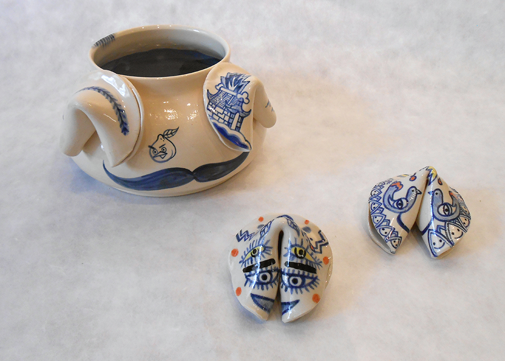 "Jiha Moon  Hipster Mustache Blue Willow (and Fortune Cookies)  Earthenware ceramic 10.5 "" x 11""x 4.5"" 2014"