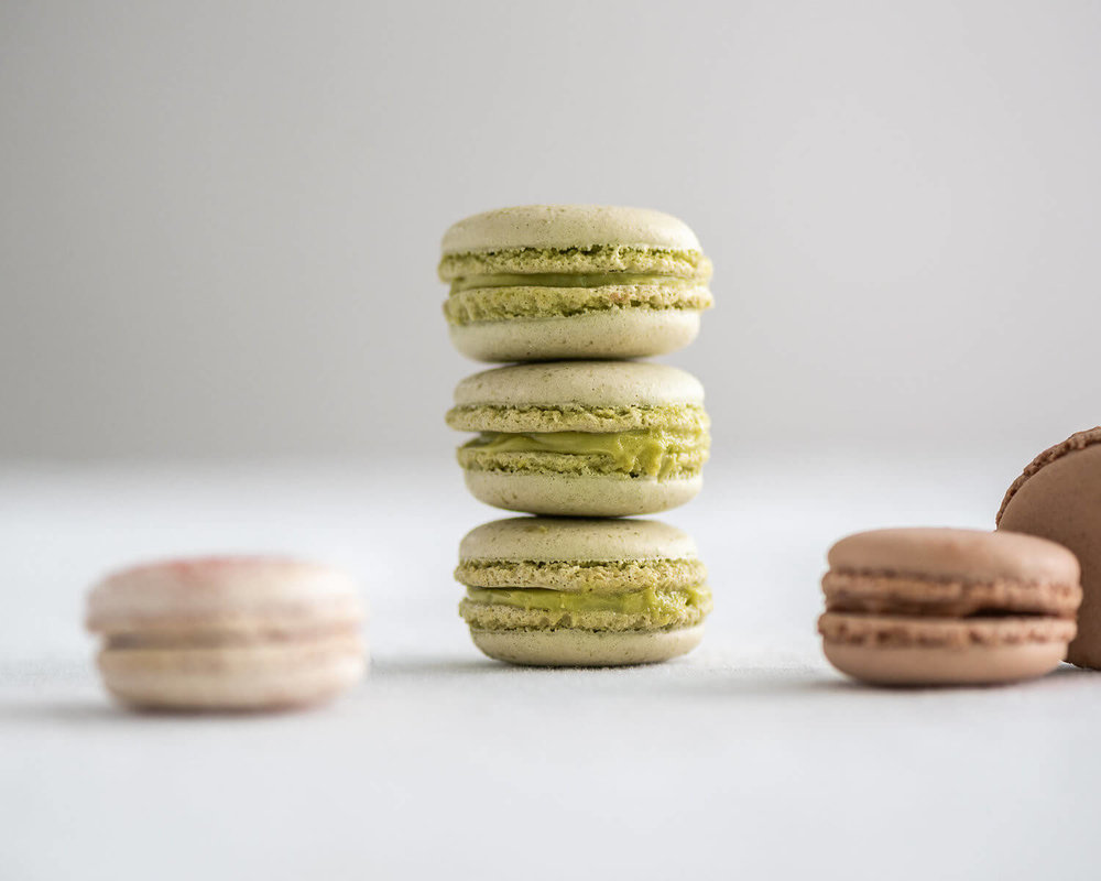 pistachio raspberry chocolate french macarons stacked.jpg