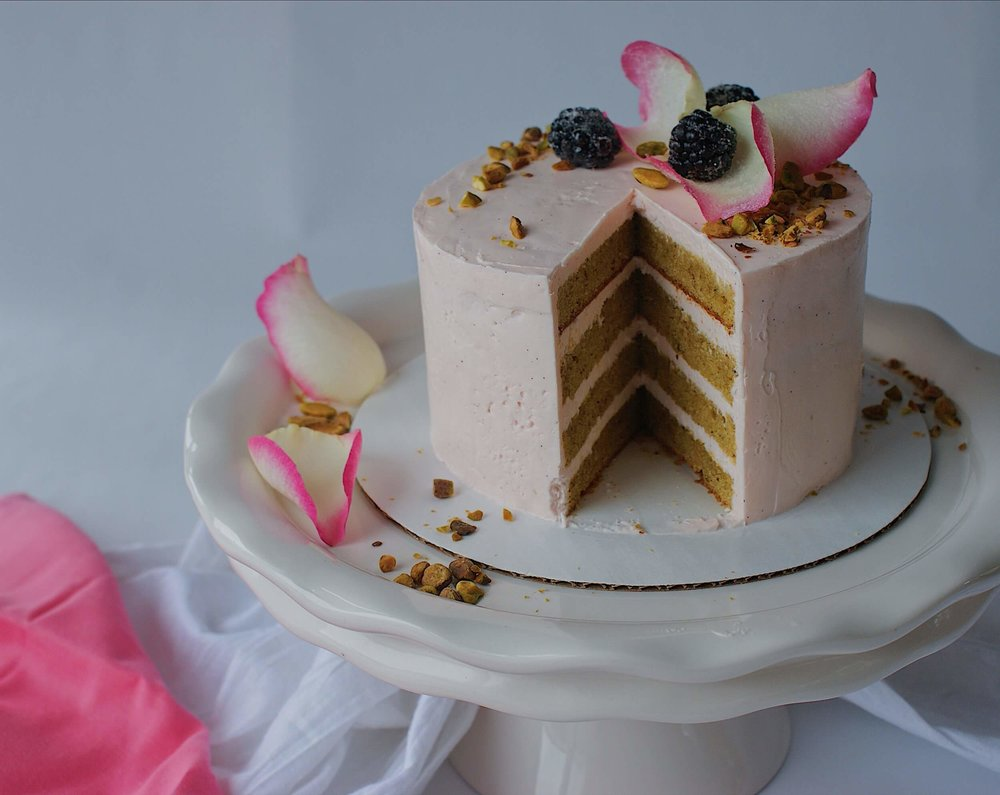 pistachio rose layer cake pink buttercream sliced.jpg