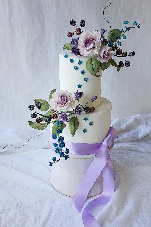 moody sugar flowers berries tiered wedding cake.jpeg