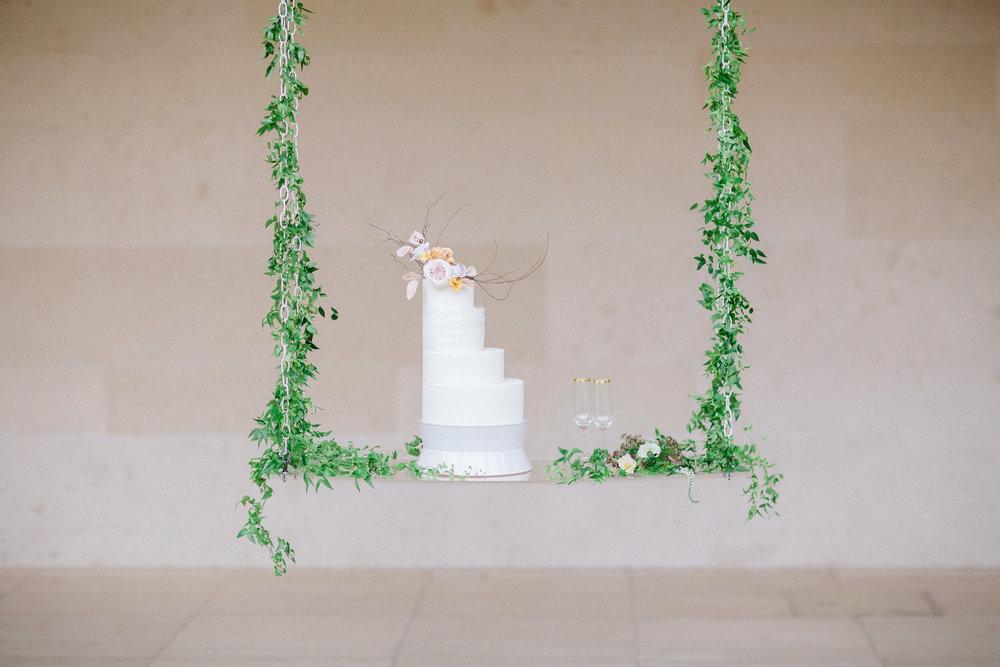 wisconsin bride wedding cake assymetrical on swing.jpg