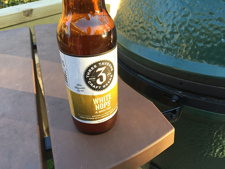 Grilling on the green egg, enjoying some Three Taverns goodness.