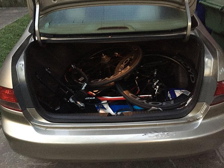 Early morning, trunk full of bike.