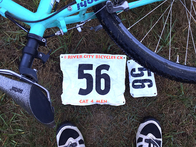 RACE NUMBERS!!! I didn't know what to do with the little number. On the line I saw the other racers had put them on their shoulders.
