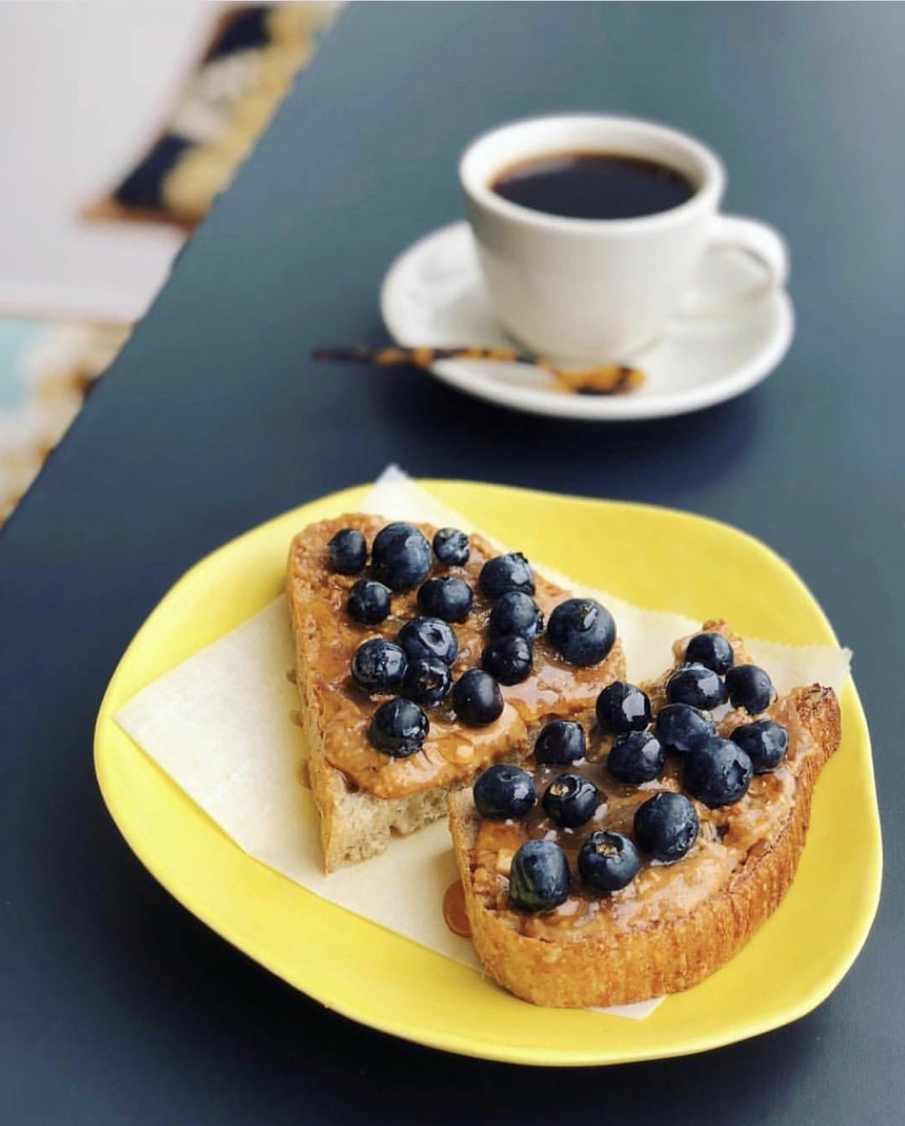 Midnight Cowboy     @bakerskneaded    Pain au Levain bread is delicately slathered with peanut pecan nut butter by    @bigspoonroasters   ,    @brinsjam    banana jam, drizzled Coffee Blossom Honey and topped with organic blueberries, yes please!   Recipe:  @hifiespresso   Photo:  @jeffprugh