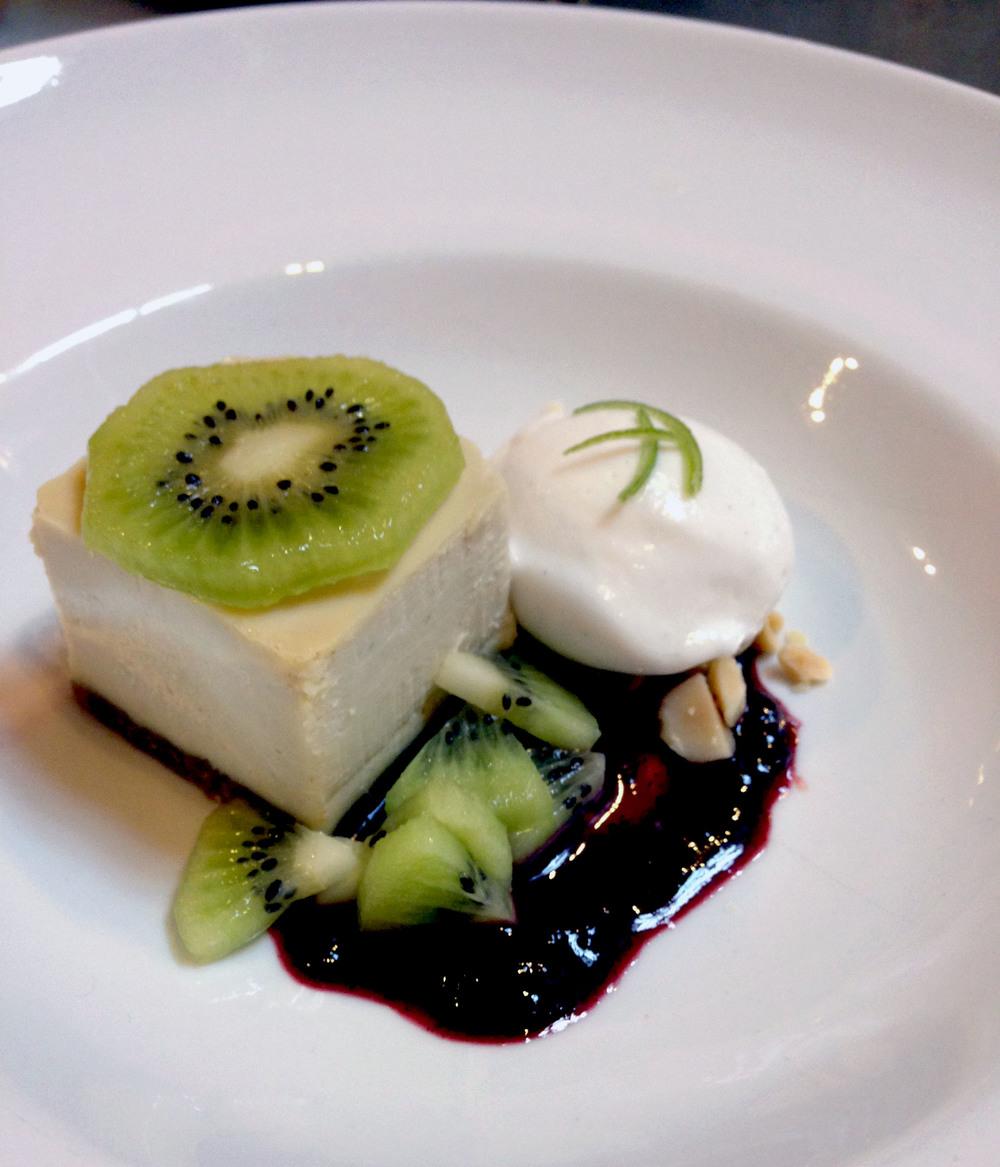 Key lime cheesecake, kiwi, smoked blackberry sauce, candied macadamia nuts, coconut sorbet